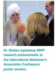 Dr. Khalsa explaining ARPF research achievements at the International Alzheimer's Association Conference