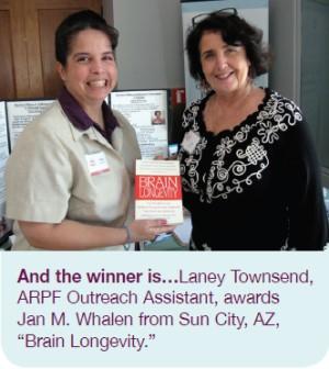 And the winner is... Laney Townsend, ARPF Outreach Assistant, awards Jan M. Whalen from Sun City, AZ, 'Brain Longevity.'